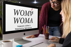 pair-of-women-using-an-imac-template-while-at-the-office-a16262